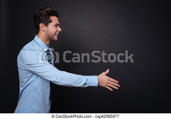 Positive young usinessman shaking hands - csp42085977