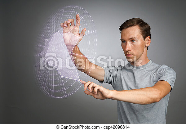 Young man working with interactive Sci-Fi HUD interface. High-tech concept.