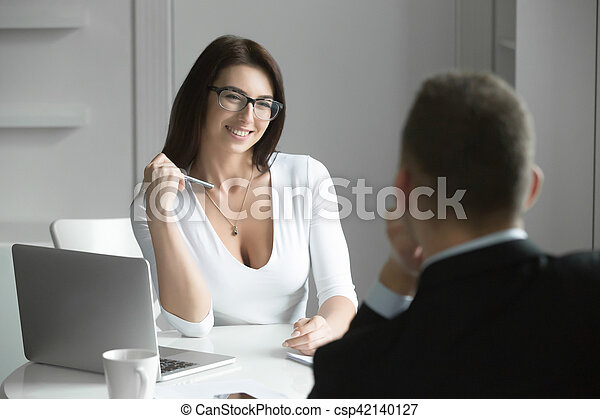 Beautiful businesswoman talking to a male job applicant - csp42140127