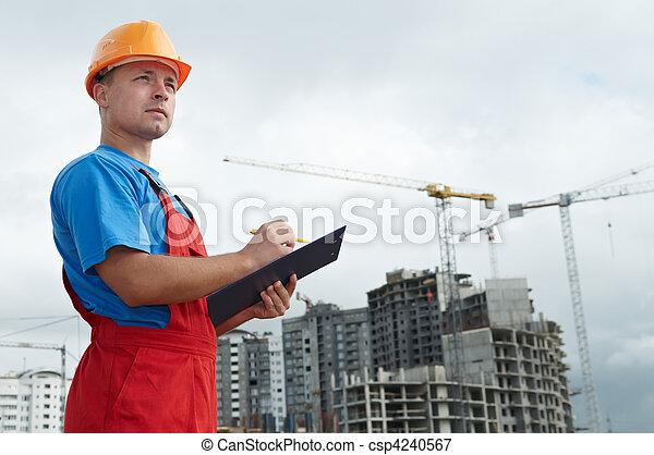 Builder inspector at construction area - csp4240567