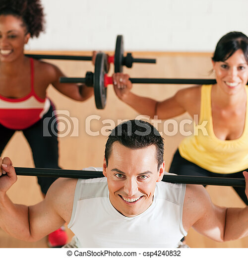Fitness group with barbell in gym - csp4240832