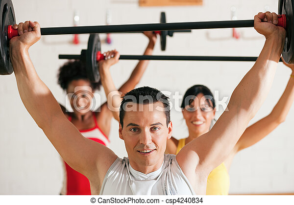 Fitness group with barbell in gym - csp4240834