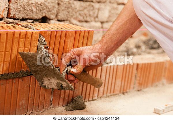 bricklayer making wall with brick  - csp4241134