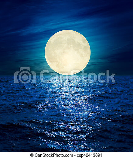 big moon in clouds over night sea