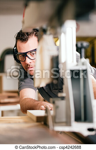 Carpenter using electric saw - csp4242688