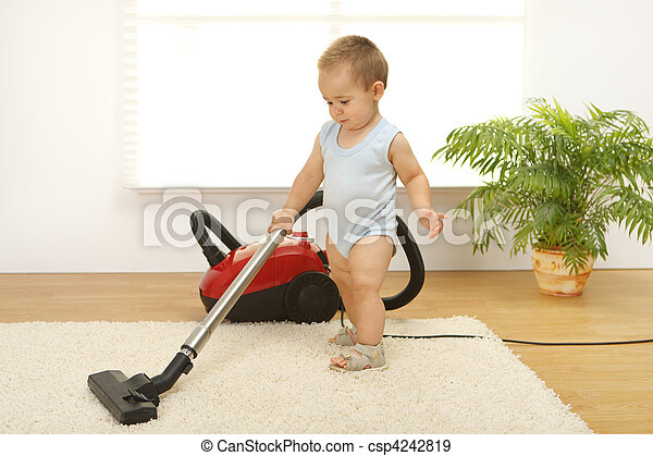 Baby boy with vacuum cleaner - csp4242819