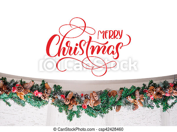 decor of spruce branches with buds and text Merry Christmas. Calligraphy lettering.