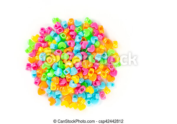 Children's plastic beads isolated on white background - csp42442812