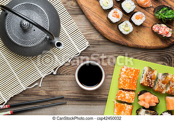 Set of sushi rolls with eel, salmon, avocado, and other products, Asian food
