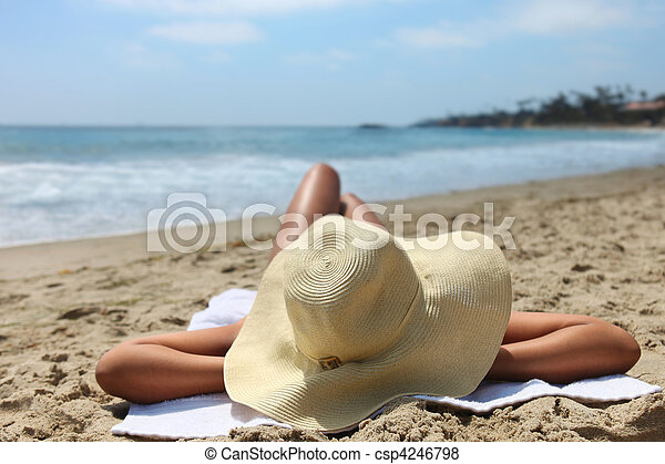 Woman Laying Out Sunbathing at the Beach