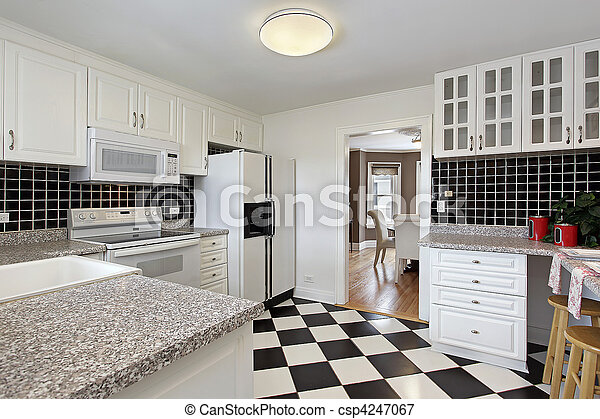 Kitchen with checkerboard floor - csp4247067