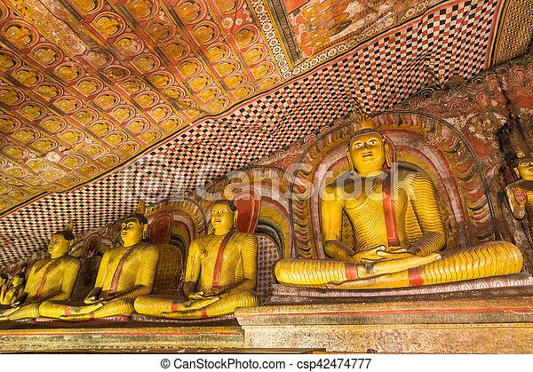 Statues of Buddha, Dambulla Cave Temple, Sri Lanka. - csp42474777