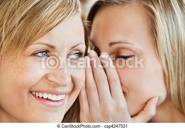 Blond young woman telling her friend a secret - csp4247531