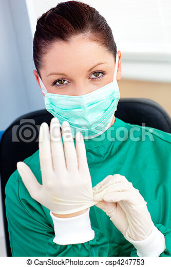 Sophisticated surgeon wearing scrubs and a mask in a hospital - csp4247753