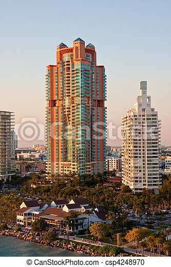 Rose Colored Condo Tower Rising in Morning Light - csp4248970