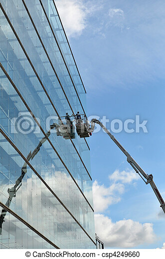 The man during the cleaning of big glass building - csp4249660