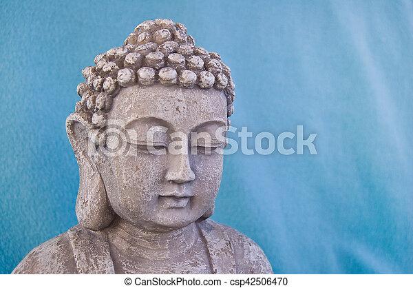 Buddha face on blue background. Symbol of Buddhism religion