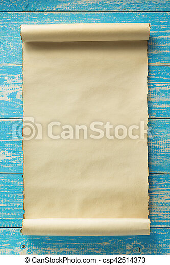 parchment scroll at old wooden background
