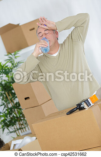 exhausted man with card boxes over him