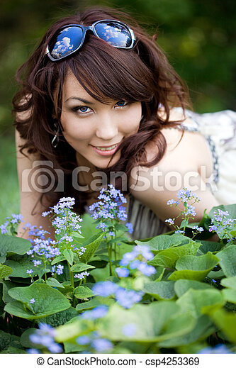 tender girl in the garden with flowers - csp4253369