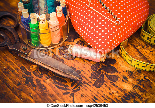 Many sewing tools for hand-made gifts in granny\'s drawer.