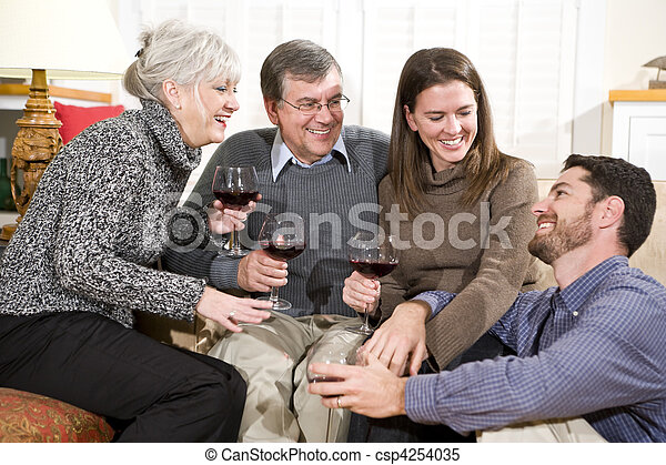 Mid-adult and senior couples enjoying conversation - csp4254035