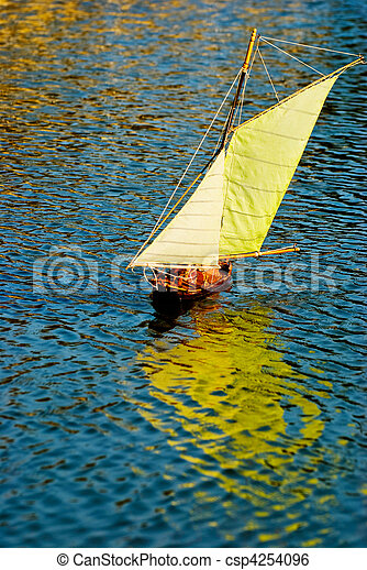 Handmade remote control sailboat on lake - csp4254096