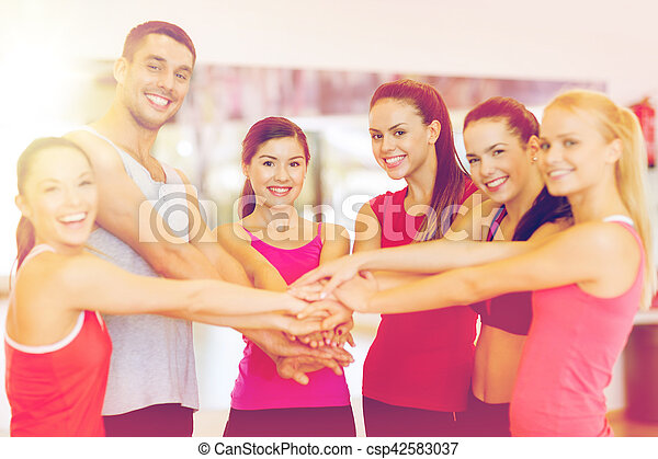 fitness, sport, training, gym, success and lifestyle concept - group of happy people in the gym celebrating victory