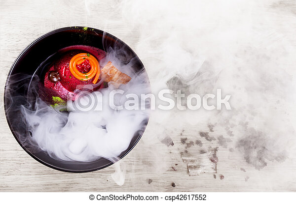 Molecular Cuisine. Delicious soup with beetroot. - csp42617552