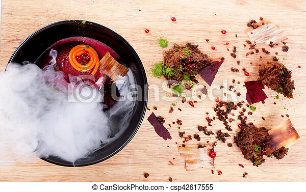 Molecular Cuisine. Delicious soup with beetroot. - csp42617555