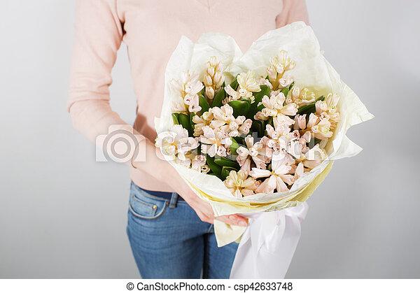 Florist at work. Make bouquet hyacinth. Bunch in their hands.