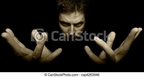 Hands and face of evil magician in the dark - csp4263946