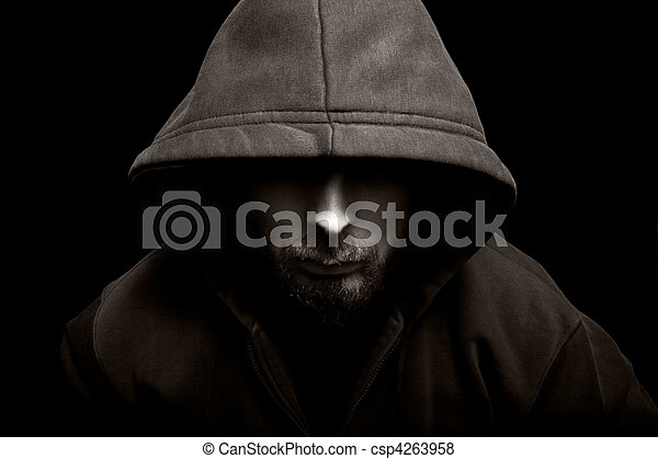 Scary evil man with hood in the dark - csp4263958