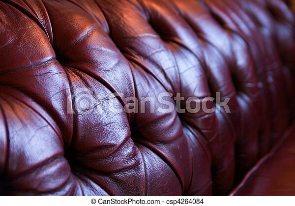 Red leather chesterfield sofa - csp4264084