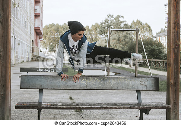young people practicing parkour in the city