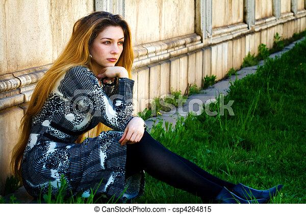 Solitude - sad pensive woman sitting alone - csp4264815
