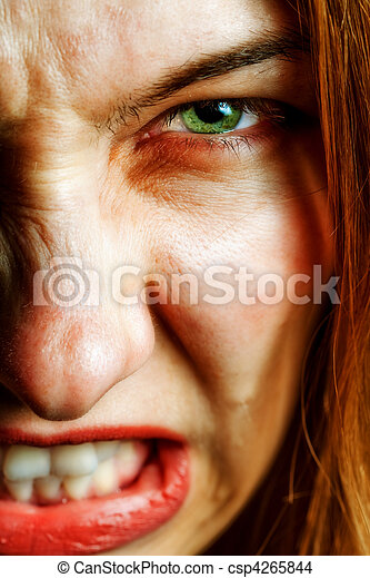 Face of angry woman with evil scary eyes - csp4265844