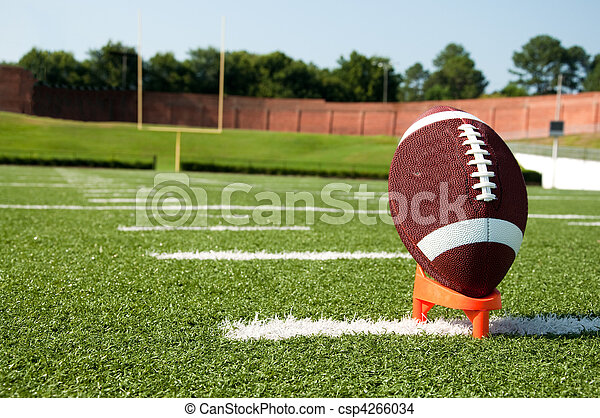 Closeup of American Football on Tee on Field - csp4266034