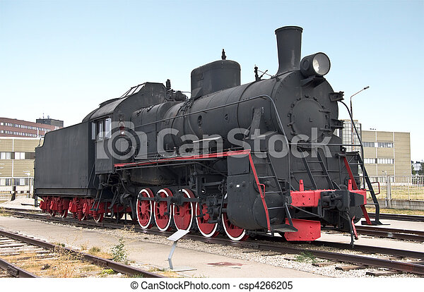 Steam locomotive beside a railway station platform. Retro train. - csp4266205