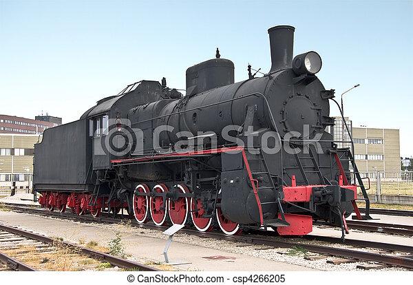 Steam locomotive beside a railway station platform. Retro train. - csp4266205