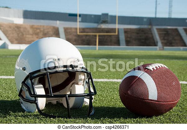 American Football and Helmet on Field - csp4266371