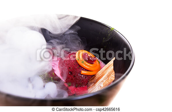 Molecular Cuisine. Delicious soup with beetroot. - csp42665616