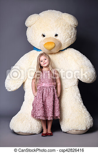 Kid and big white teddy bear, stuffed animals, plush animals, big plush toys, kids and gifts, lilac dress, blonde girl, baby in studio,