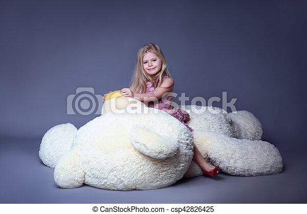 Kid hugging big plush bear, stuffed animals, plush animals, big plush toys, kids and gifts, lilac dress, blonde girl, baby in studio,