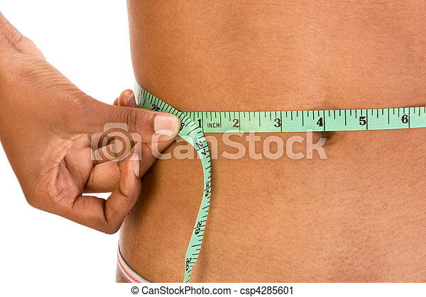 Measuring waist, close up of ethnic woman abdomen - csp4285601