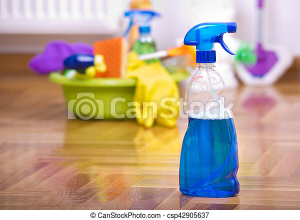 Close up of spray bottle for floor cleaning with different cleaning supplies and equipment in background