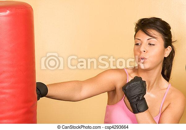 Women exercising on weightlifting machine - csp4293664