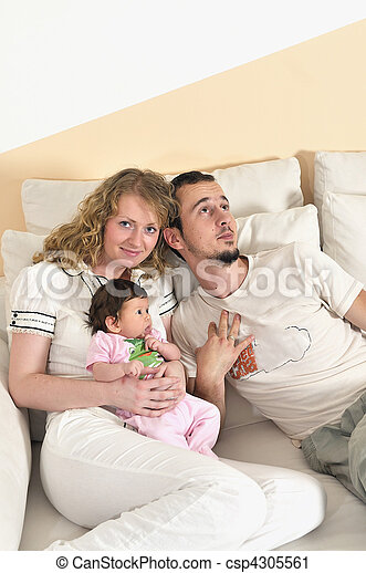 indoor portrait with happy young family and  cute little babby - csp4305561