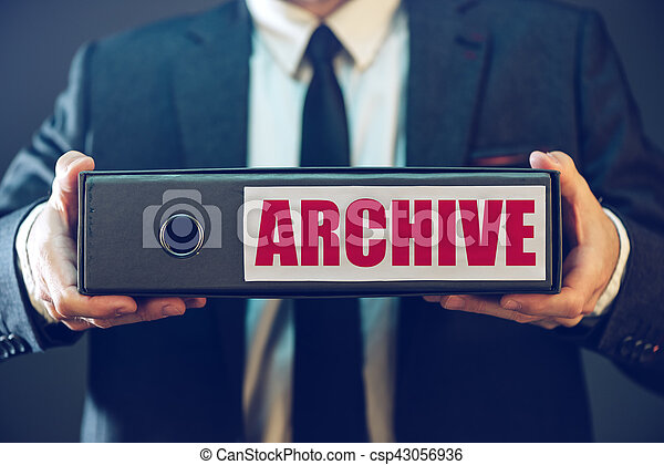 Businessman with archive files in document ring binder, paperwork and legal corporate papers collected