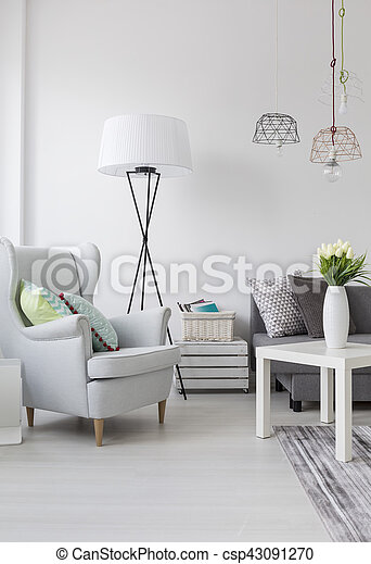 Bright living room with a white armchair and lamp - csp43091270